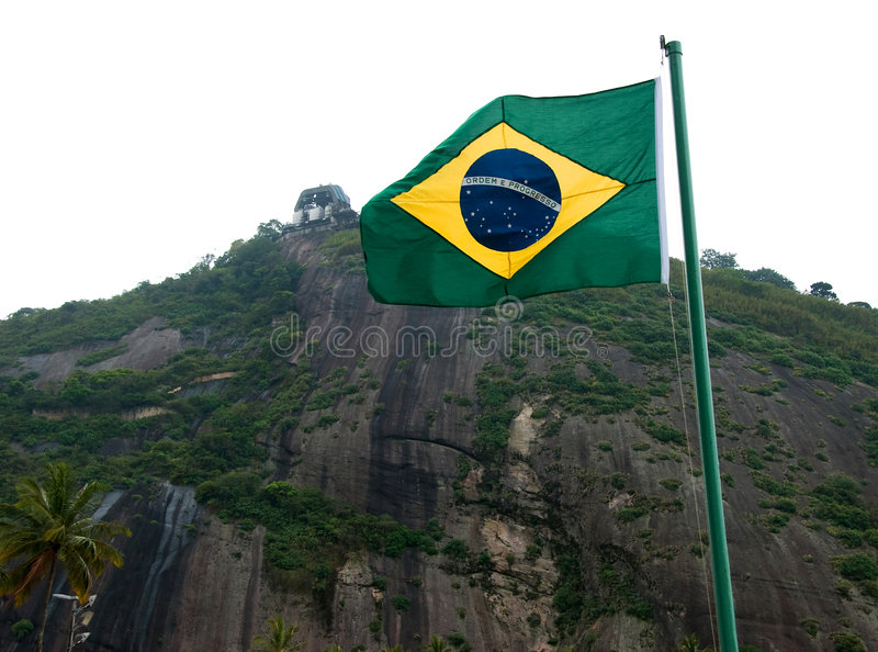 Brazil Flag. With Sugar Loaf first station in the back royalty free stock photography