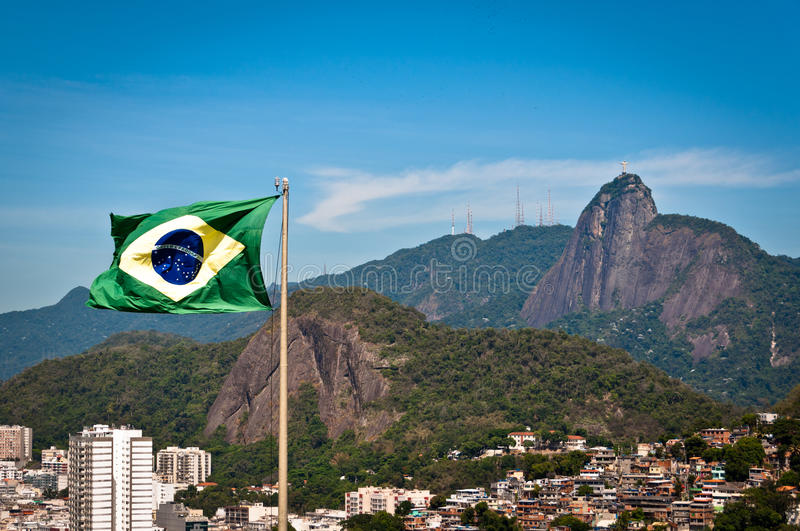Brazil Flag and Corcovado Mountain with Christ the Redeemer. Waving Brazilian Flag with Corcovado Mountain in the Background, Rio de Janeiro, Brazil royalty free stock image
