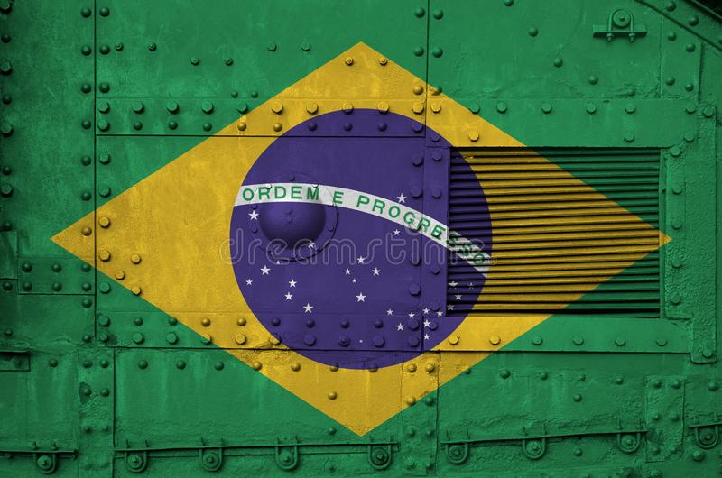 Brazil flag depicted on side part of military armored tank closeup. Army forces conceptual background. Brazil flag depicted on side part of military armored tank stock images