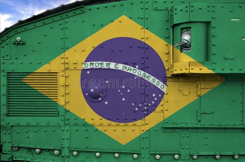 Brazil flag depicted on side part of military armored tank closeup. Army forces conceptual background. Brazil flag depicted on side part of military armored tank royalty free stock image