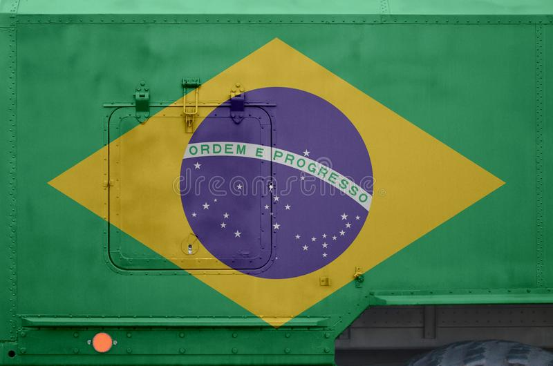 Brazil flag depicted on side part of military armored truck closeup. Army forces conceptual background. Brazil flag depicted on side part of military armored royalty free stock photos