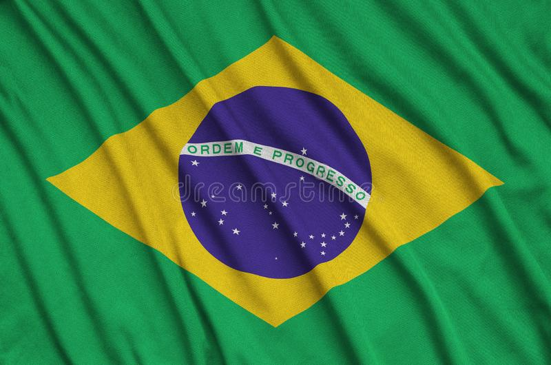 Brazil flag is depicted on a sports cloth fabric with many folds. Sport team banner. Brazil flag is depicted on a sports cloth fabric with many folds. Sport team stock image