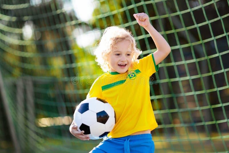 Brazil football fan kids. Children play soccer stock image