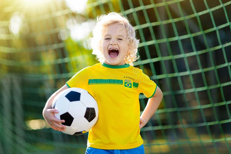 Brazil football fan kids. Children play soccer. royalty free stock photo