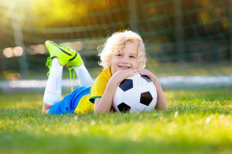Brazil football fan kids. Children play soccer. stock photography