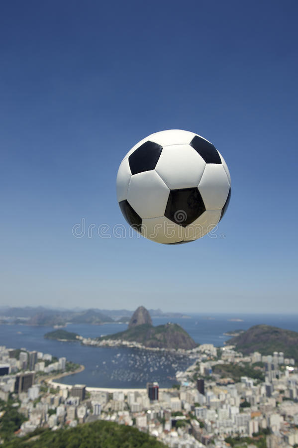 Brazil Football Soccer Ball Above Rio de Janeiro. Football soccer ball above Rio de Janeiro skyline with Sugarloaf Pao de Acucar Mountain in the background stock image
