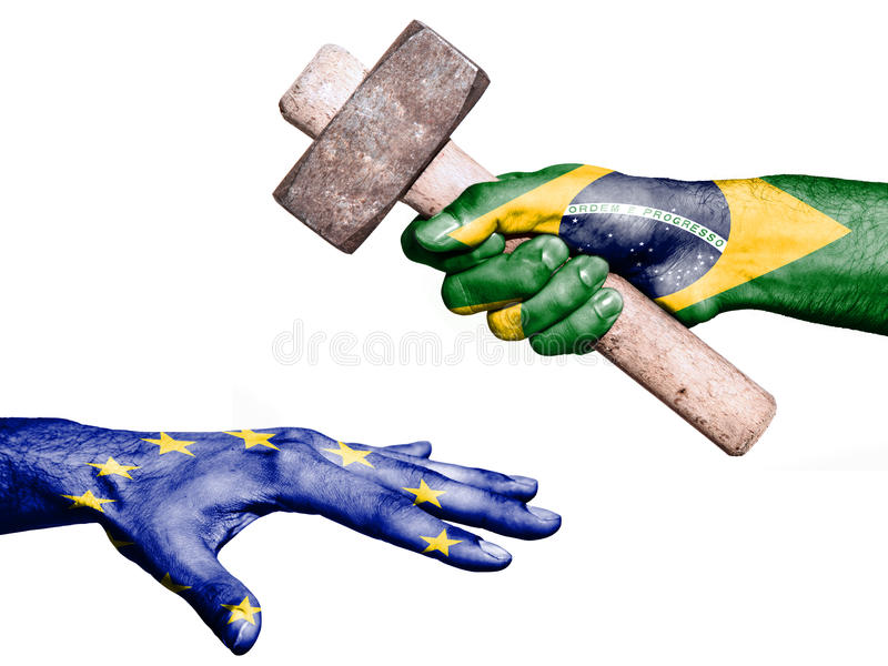Brazil hitting European Union with a heavy hammer. Flag of Brazil overprinted on a hand holding a heavy hammer hitting a hand representing the European Union royalty free stock photo