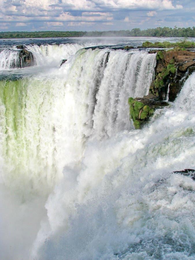 Brazil: Iguazu Waterfalls, seen from the Argentinian side. Brazil: Iguazu Waterfalls, seen from the Argentinian side, with a huge amount of water falling stock photo