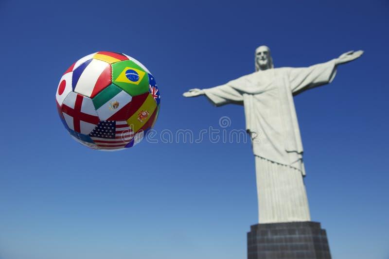 Brazil International Football Soccer Ball Corcovado Rio de Janeiro. Brazil international flag football soccer ball in the air bright blue sky Corcovado Cristo stock photos
