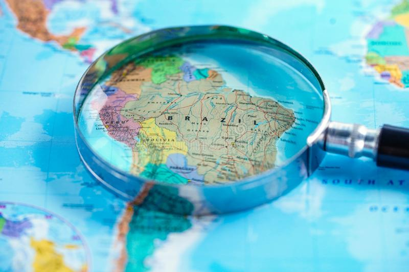 Brazil : Magnifying glass with world glove map. stock images