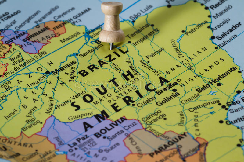 Brazil on a map. Push pin on a world map marking Brazil as a destination concept stock images