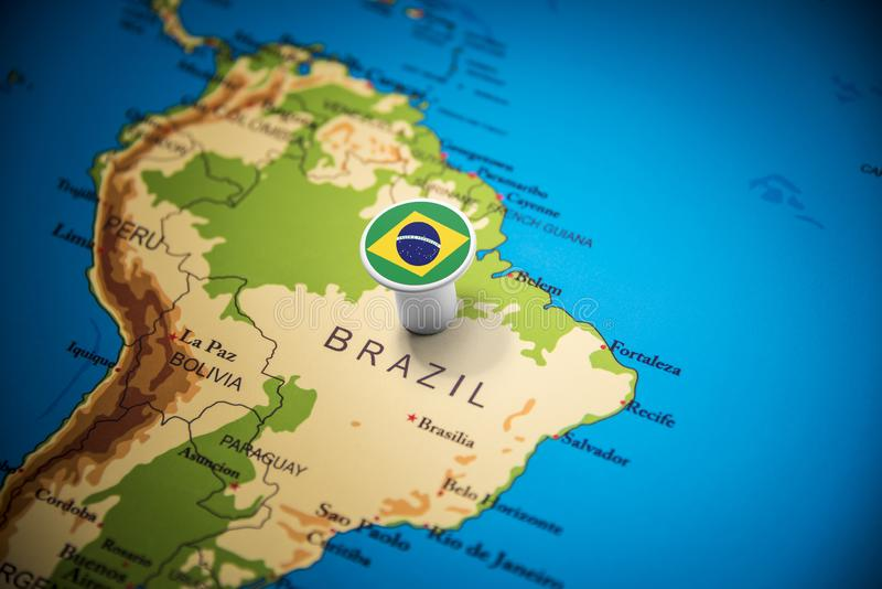 Brazil marked with a flag on the map.  stock photos