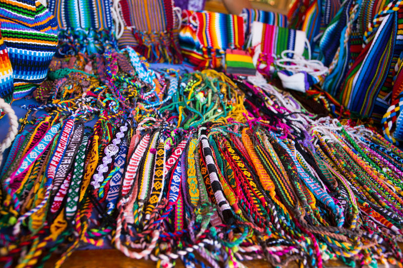 Brazil and paraguay textiles close up. Brazil and paraguay textiles souvenirs - bags, friendship bracelets, brasil royalty free stock image