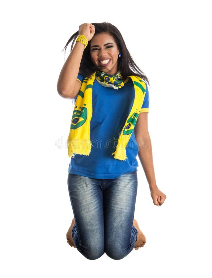 Brazilian woman fan celebrating on football match on white background. Brazil colors. stock images