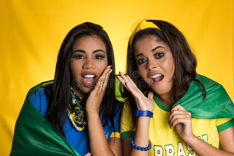 Two brazilian friends celebrating on soccer / football match on royalty free stock image