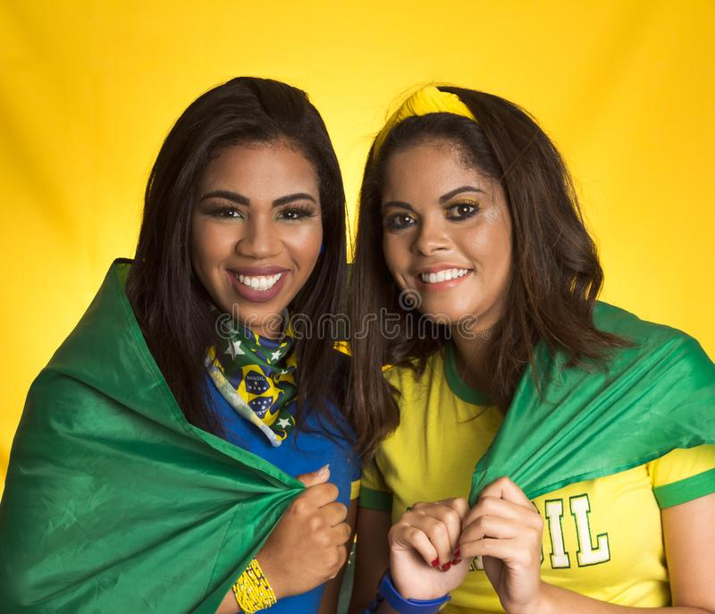 Two brazilian friends celebrating on soccer / football match on royalty free stock photo