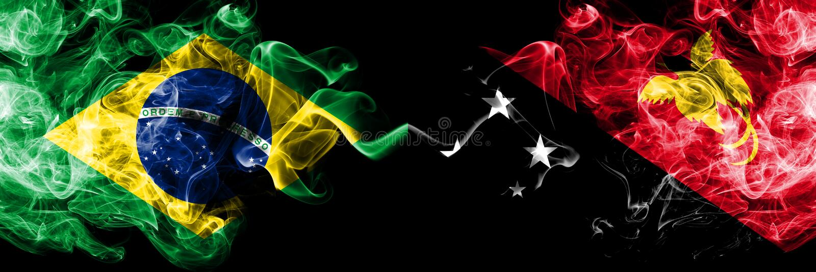 Brazil vs Papua New Guinea smoke flags placed side by side. Thick colored silky smoke flags of Brazilian and Papua New Guinea.  stock photography