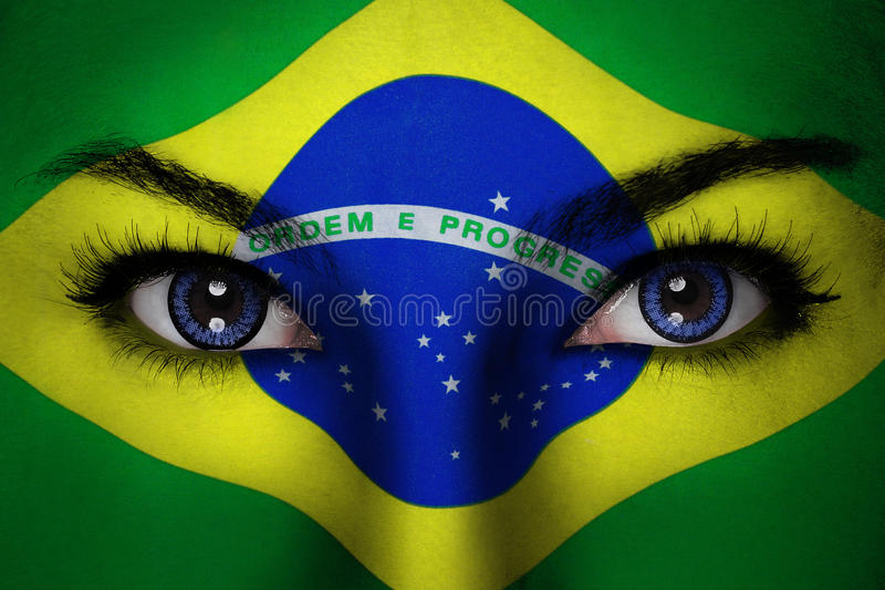 Brazil woman face. Woman with Brazil flag painted on her face