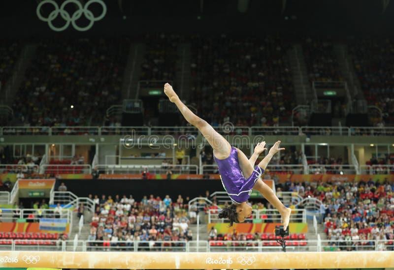 Brazilian artistic gymnast Rebeca Andrade competes on the balance beam at women`s all-around gymnastics at Rio 2016 Olympic Games. RIO DE JANEIRO, BRAZIL royalty free stock photos