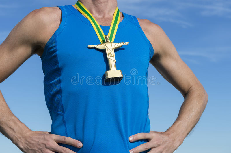 Brazilian Athlete with Cristo Gold Medal. Brazilian athlete standing with religious gold medal in the form of a miniature statue of Cristo Redentor (Jesus Christ royalty free stock photos