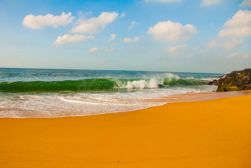 Brazilian beach with yellow sand and blue sea in Sunny weather. Brazil. Salvador. South America stock photo