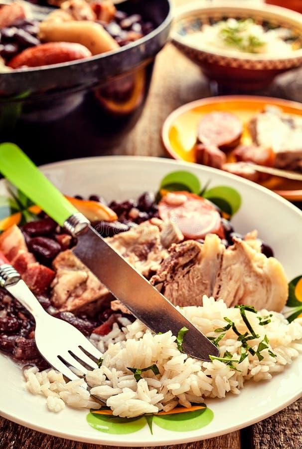 Brazilian bean Feijoada with pork spare ribs stock photos