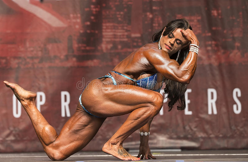Brazilian Beauty Displays Muscle at Toronto Contest stock images