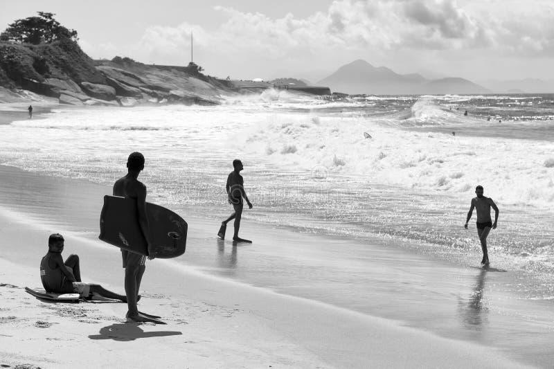 Brazilian Body Boarders on Shore Rio de Janeiro Brazil. RIO DE JANEIRO, BRAZIL - MARCH 24 2015: Body boarders get ready to hit the waves of Praia do Diabo (Devil royalty free stock photos