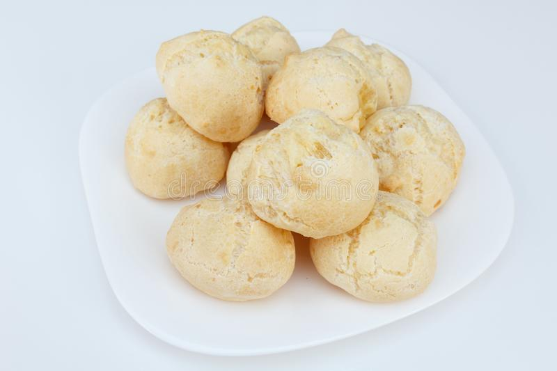Brazilian breakfast, cheese bread pao de queijo served on dish on white table stock photography