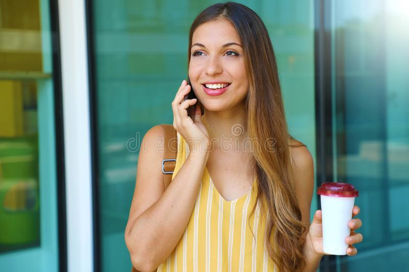Brazilian business woman have a coffee while calling with phone outdoor royalty free stock images