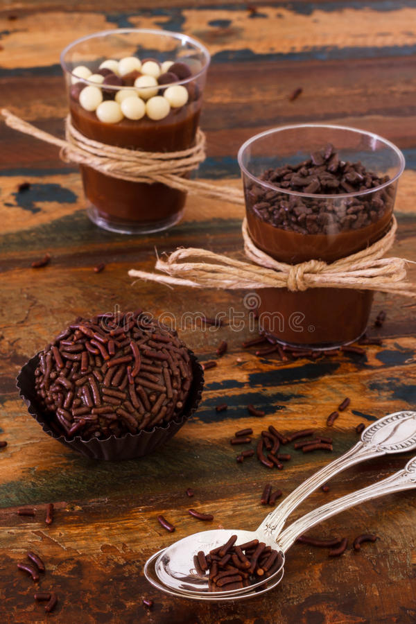 Brazilian chocolate bonbon truffle brigadeiro. With spoon on wooden table stock images