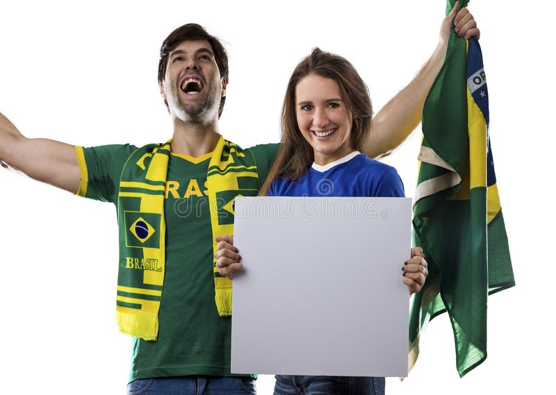 Brazilian couple Celebrating on a white background . stock photography