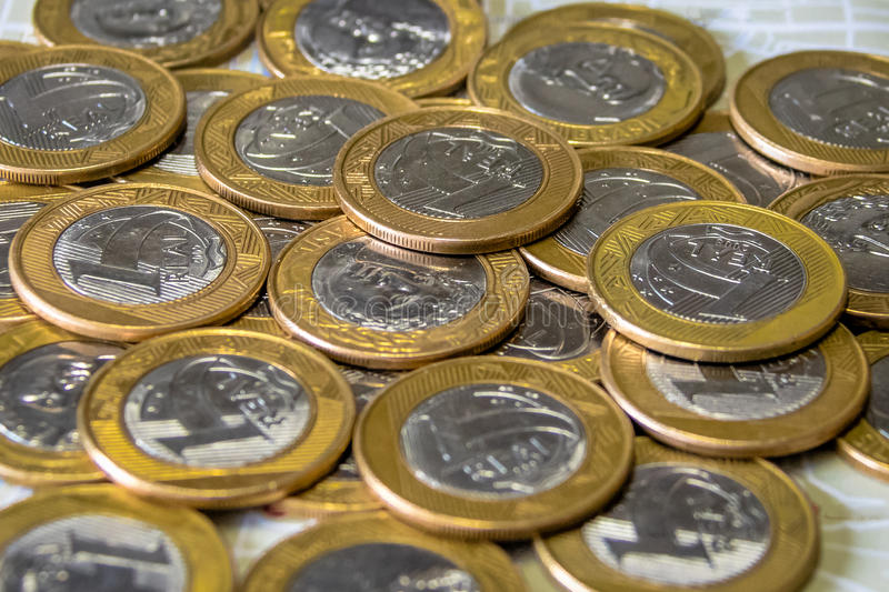 Brazilian currency - One Real coins royalty free stock photography