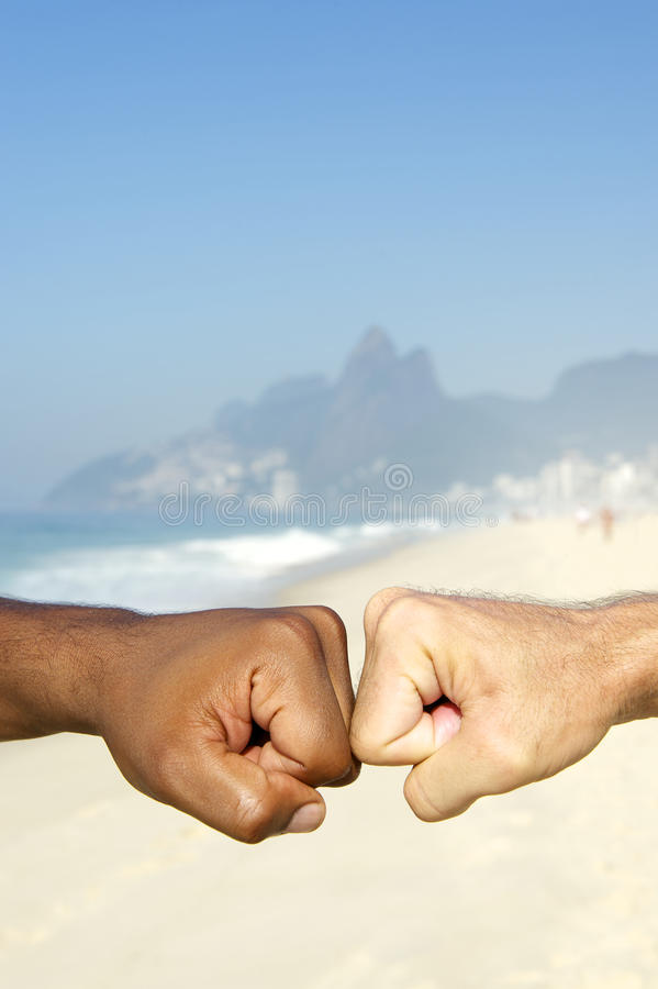 Brazilian Diversity Interracial Hands Together Rio Brazil. Fist bump Brazilian diversity interracial hands cooperating together Ipanema Beach Rio de Janeiro royalty free stock images