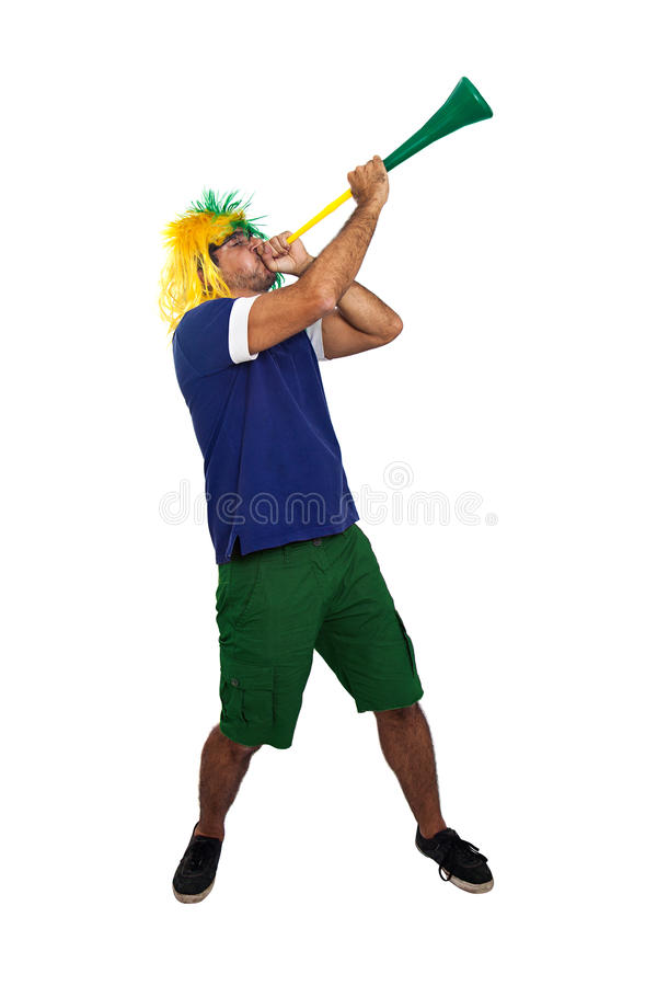 Brazilian fan blowing a stadium horn royalty free stock images