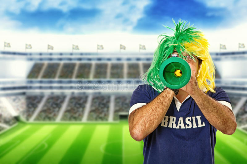 Brazilian fan celebrating a goal royalty free stock images