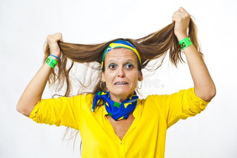 Brazilian fan desperate pulling hair royalty free stock images