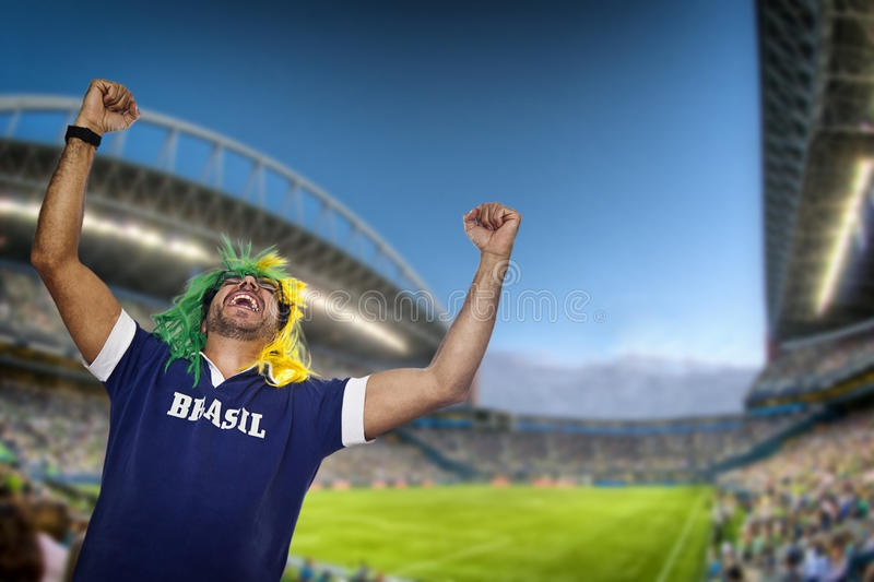 Brazilian fan screaming at stadium stock images