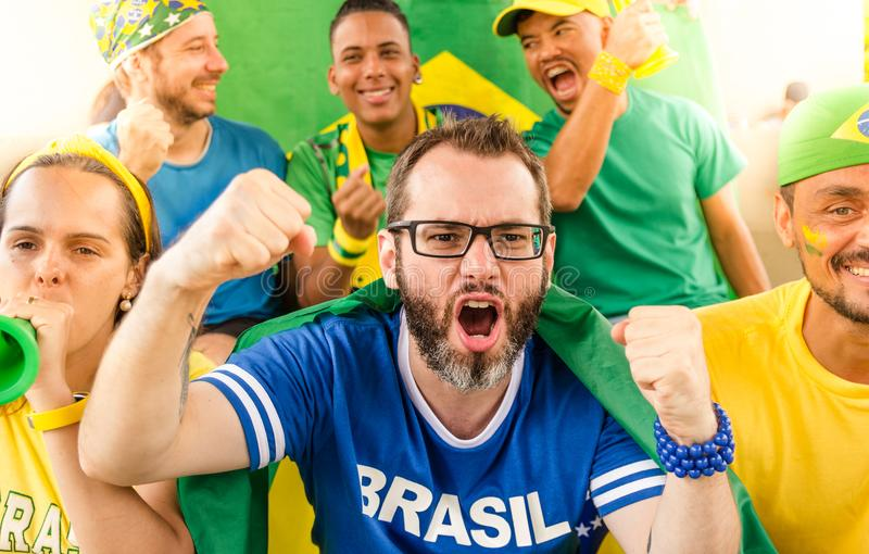 Brazilian fans at stadium. Cheering. royalty free stock photo