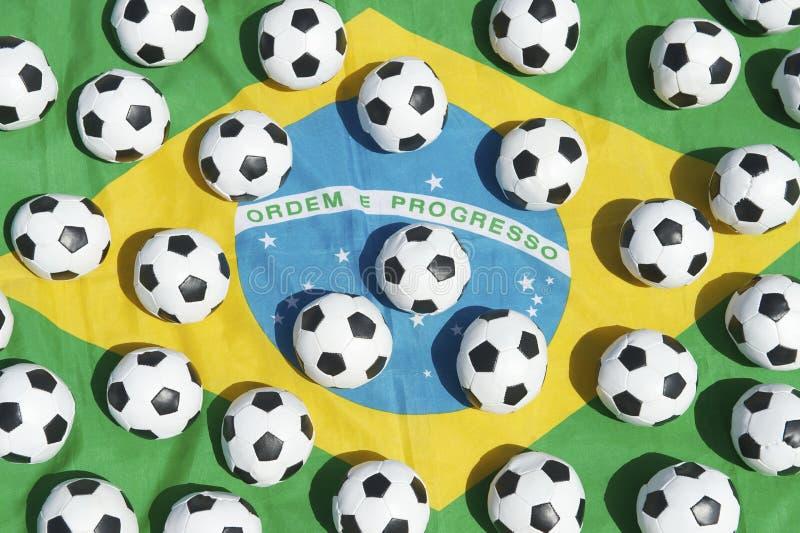 Brazilian Flag Football Soccer Balls. Brazil flag with many small football soccer balls in outdoors in bright Brazilian sunshine stock photos