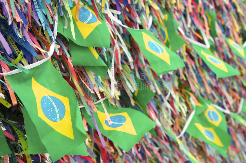 Brazilian Flags Wish Ribbons Bonfim Salvador Bahia. Brazilian flags fly on a wall of wish ribbons at the famous Church Igrega Nosso Senhor do Bonfim Salvador stock photo
