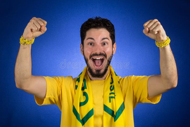 Brazilian supporter of National football team is celebrating, ch stock photography