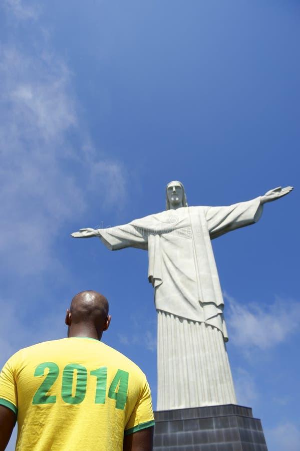 Brazilian Football Soccer Player 2014 Shirt Corcovado Rio de Janeiro. Brazilian football soccer player in 2014 shirt at Corcovado Cristo Redentor Rio de Janeiro stock images