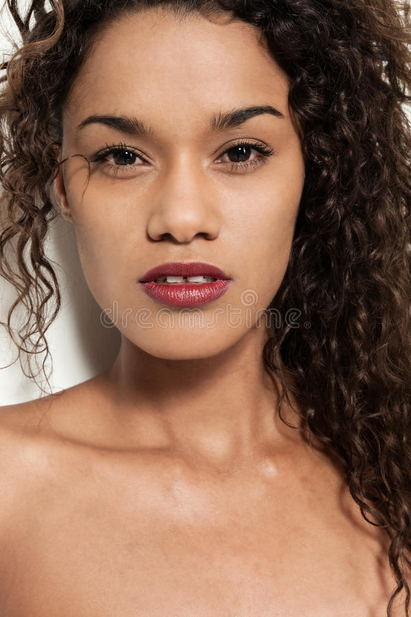Brazilian girl with curly hair royalty free stock photos