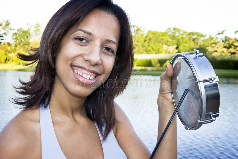 Brazilian Girl playing samba royalty free stock photography