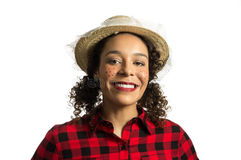 Brazilian girl wearing red plaid shirt on white background. Woman dressing checked pattern clothes smiling and happy stock photo