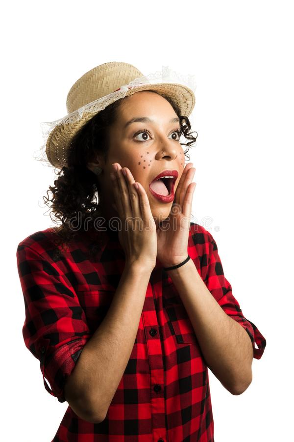 Brazilian girl wearing red plaid shirt on white background. Woman dressing checked pattern clothes is suprised royalty free stock photos