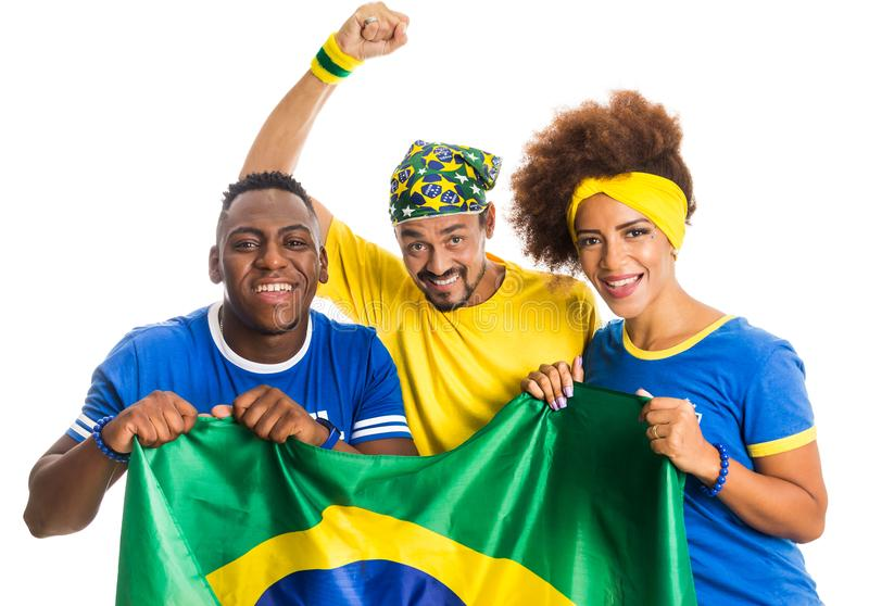Brazilian group of fans celebrating on football match on white b. Brazil supporters. Brazilian group of fans celebrating on soccer / football match on white stock image