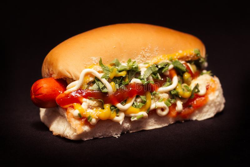 Brazilian hot dog, black background. Brazilian hot dog in black background, fast food from Brazil stock image