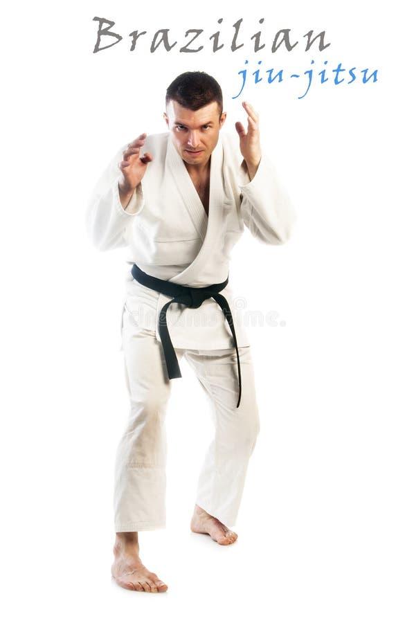 Brazilian jiu-jitsu. Young handsome man practicing Brazilian jiu-jitsu (BJJ) isolated on white background stock photos